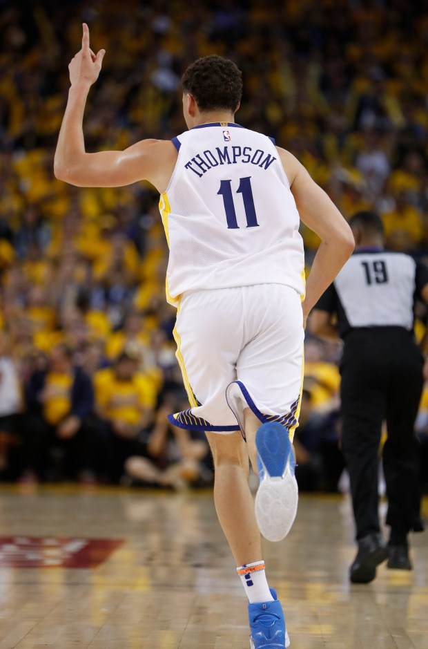 Golden State Warriors' Klay Thompson (11) celebrates his 3-point basket against the San Antonio Spurs in the fourth quarter of Game 1 of their NBA first-round playoff series at the Oracle Arena in Oakland, Calif., on Saturday, April 14, 2018. (Nhat V. Meyer/Bay Area News Group)