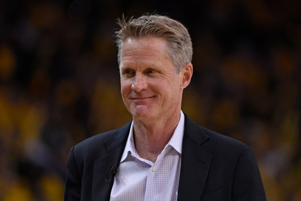 Golden State Warriors head coach Steve Kerr smiles while playing the San Antonio Spurs during the fourth quarter of Game 2 of their NBA first-round playoff series at Oracle Arena in Oakland, Calif., on Monday, April 16, 2018. The Golden State Warriors defeated the San Antonio Spurs 116-101. (Jose Carlos Fajardo/Bay Area News Group)