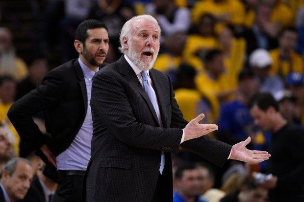 San Antonio Spurs head coach Gregg Popovich gestures to an official while playing the Golden State Warriors during the fourth quarter of Game 2 of their NBA first-round playoff series at Oracle Arena in Oakland, Calif., on Monday, April 16, 2018. The Golden State Warriors defeated the San Antonio Spurs 116-101. (Jose Carlos Fajardo/Bay Area News Group)