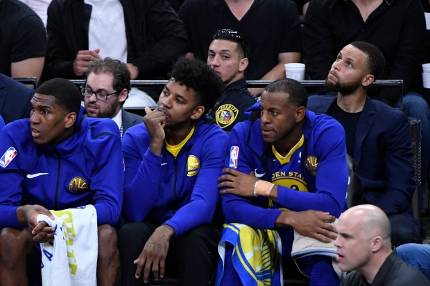 Golden State Warriors' Stephen Curry (30) sits behind the bench as they play the San Antonio Spurs during the second quarter of Game 3 of their NBA first-round playoff series at AT&T Center in San Antonio, Texas, on Thursday, April 19, 2018. (Jose Carlos Fajardo/Bay Area News Group)