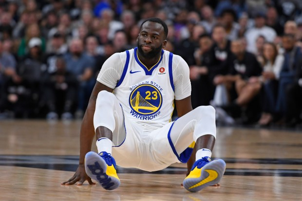 Golden State Warriors' Draymond Green (23) gets up after being knocked down while playing against the San Antonio Spurs during the second quarter of Game 4 of their NBA first-round playoff series at AT&T Center in San Antonio, Texas, on Sunday, April 22, 2018. (Jose Carlos Fajardo/Bay Area News Group)