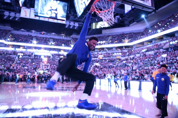 Golden State Warriors' Jordan Bell (2) hangs on the rim before the start of Game 4 of their NBA first-round playoff series at AT&T Center in San Antonio, Texas, on Sunday, April 22, 2018. (Jose Carlos Fajardo/Bay Area News Group)