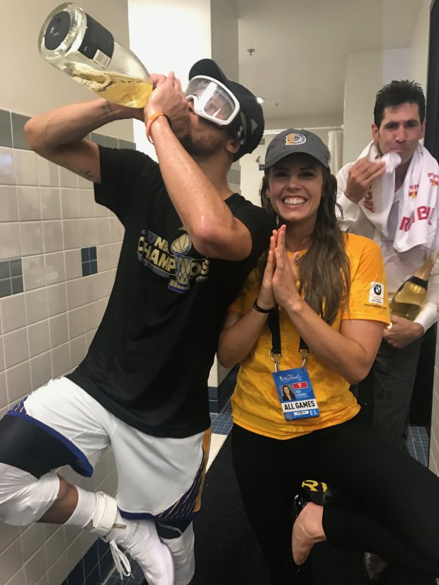 Warriors guard Stephen Curry, left, joins yoga instructor Lisa Goodwin in celebration after the Warriors won the NBA title last season. Goodwin is also the team's senior director of corporate communications. (Courtesy: Golden State Warriors)