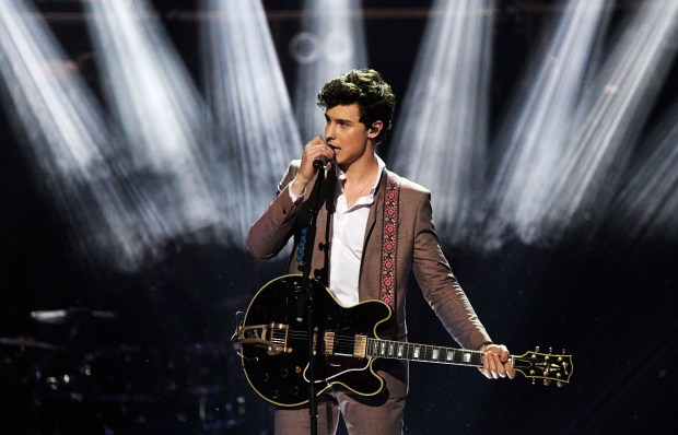 Shawn Mendes performs at the Royal Albert Hall in London on Saturday April 21, 2018, for a concert to celebrate the 92nd birthday of Britain's Queen Elizabeth II. (Andrew Parsons/Pool via AP)