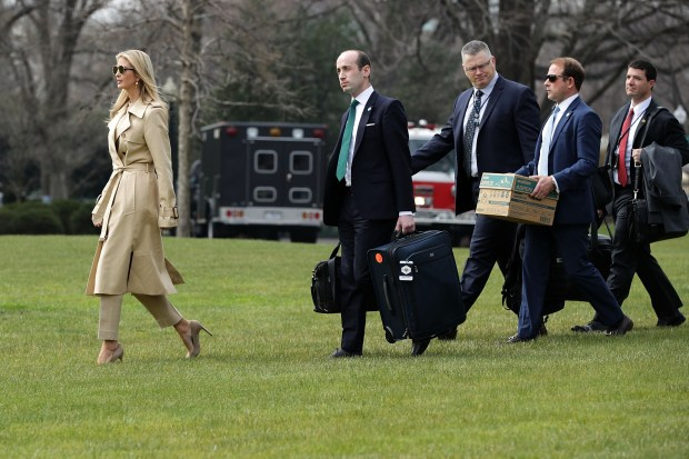 (L-R) Ivanka Trump, White House Senior Advisor Stephen Miller, Deputy National Security Advisor Ricky Waddell and Deputy Director of Presidential Advance Jordan Karem walk across the South Lawn before departing the White House with U.S. President Donald Trump March 29, 2018 in Washington, DC. President Trump is traveling to Ohio to deliver a speech on infrastructure before continuing on to Palm Beach for the Easter holiday weekend. (Photo by Chip Somodevilla/Getty Images)