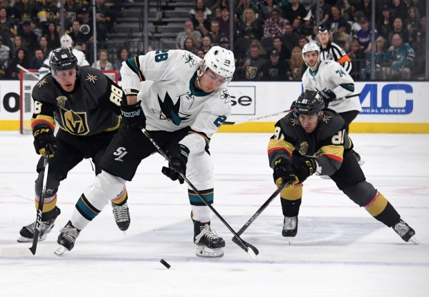 LAS VEGAS, NV - MARCH 31: Timo Meier #28 of the San Jose Sharks skates with the puck under pressure from Nate Schmidt #88 and Jonathan Marchessault #81 of the Vegas Golden Knights in the first period of their game at T-Mobile Arena on March 31, 2018 in Las Vegas, Nevada. The Golden Knights won 3-2 and clinched the Pacific Division title. (Photo by Ethan Miller/Getty Images)