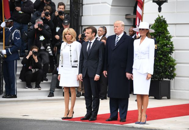 French President Emmanuel Macron (2nd L), US President Donald Trump (2nd R), First Lady Melania Trump (R) and Brigitte Macron participate in a state welcome at the White House in Washington, DC, on April 24, 2018. (Photo by JIM WATSON / AFP) (Photo credit should read JIM WATSON/AFP/Getty Images)