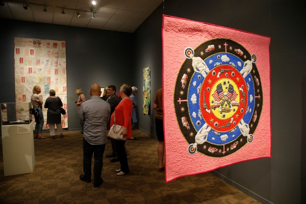 A crowd fills the San Jose Museum of Quilts and Textiles in San Jose, Calif., Sunday, April 22, 2018, for the opening of two new gun-themed exhibits. (Karl Mondon/Bay Area News Group)