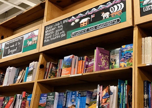 Powell's City of Books in Portland pays tongue-in-cheek homage to theclassic Oregon Trail computer game, with painted bookshelves that house Oregon trail guides and hiking books. (Jackie Burrell/Bay Area News Group)