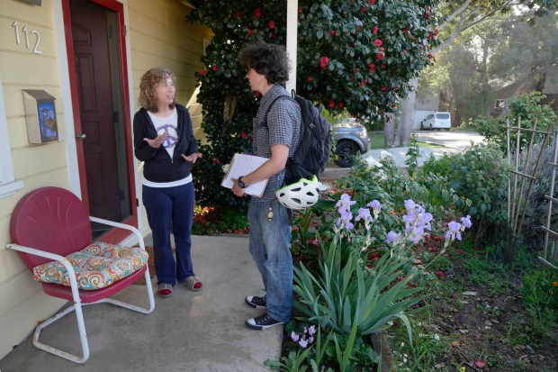 Zav Hershfield, at right, talks to Terry Teitelbaum as he canvasses the Seabright neighborhood while looking for residents to sign a rent control ballot measure on Friday, April 20, 2018, in Santa Cruz, Calif. (Jim Gensheimer/Special to Bay Area News Group)
