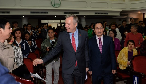 US Ambassador to Vietnam Ted Osius (center left), flanked by Phung Xuan Nha (right), President of the Vietnam National University, arrives to deliver a speech during a meeting with students at the Vietnam National University in Hanoi on March 6, 2015. The meeting is part of activities to celebrate the 20th anniversary of the normalization of relations between the United States and Vietnam. AFP PHOTO / HOANG DINH Nam (Photo credit should read HOANG DINH NAM/AFP/Getty Images)