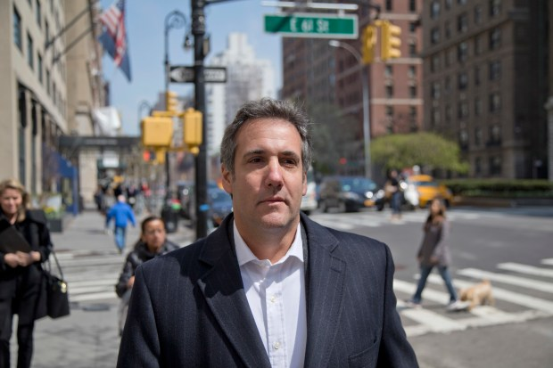 Attorney Michael Cohen walks down the sidewalk in New York, Wednesday, April 11, 2018. Federal agents who raided the office of President Donald Trump's personal attorney, were looking for information about payments to a former Playboy playmate and a porn actress who claim to have had affairs with Trump, two people familiar with the investigation said. (AP Photo/Seth Wenig)