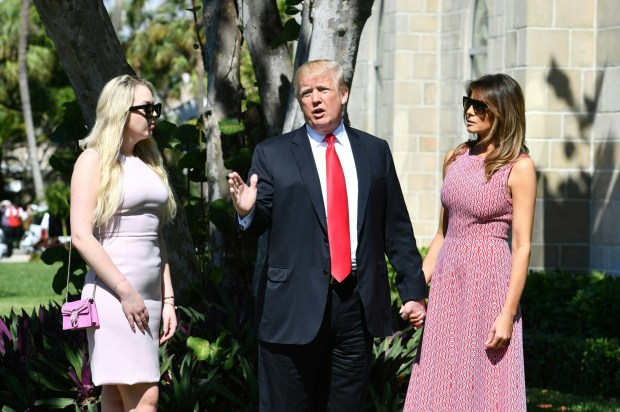 US President Donald Trump (C) with First Lady Melania Trump (R) and daughter Tiffany Trump (L) arrives for Easter service at the Church of Bethesda-by-the-Sea in Palm Beach, Florida, April 1, 2018. / AFP PHOTO / Nicholas Kamm (Photo credit should read NICHOLAS KAMM/AFP/Getty Images)