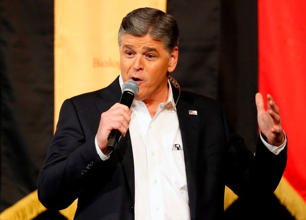 "FILE - In this March 18, 2016 file photo, Fox News Channel's Sean Hannity speaks during a campaign rally for Republican presidential candidate, Sen. Ted Cruz, R-Texas, in Phoenix. The Fox News Channel host is vowing to continue his attacks on ABC late-night comic Jimmy Kimmel until Kimmel apologizes for a segment in which he joked about first lady Melania Trump's accent. The dispute between the television personalities is unusually vitriolic, with Hannity calling Kimmel a ""sick, twisted, creepy, perverted weirdo"" during his Fox show on Friday, April 6, 2018. (AP Photo/Rick Scuteri, File)"
