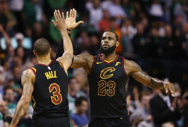 LeBron James #23 of the Cleveland Cavaliers celebrates with George Hill #3 in the second half against the Boston Celtics during Game Seven of the 2018 NBA Eastern Conference Finals at TD Garden on May 27, 2018 in Boston, Massachusetts. NOTE TO USER: User expressly acknowledges and agrees that, by downloading and or using this photograph, User is consenting to the terms and conditions of the Getty Images License Agreement. (Photo by Maddie Meyer/Getty Images)