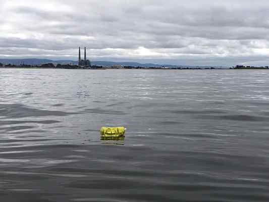 A mylar balloon floats on the Monterey Bay in front of Moss Landing. (Courtesy Monterey Bay Aquarium Research Institute)