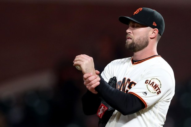 San Francisco Giants pitcher Hunter Strickland (60) rubs his wrist as San Diego Padres' Eric Hosmer (30) circles the bases after hitting a solo home run off in the ninth inning of a MLB game at AT&T Park in San Francisco, Calif., on Tuesday, May 1, 2018. Giants lost 3-2. (Ray Chavez/Bay Area News Group)