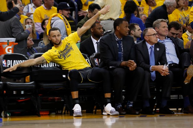 Golden State Warriors' Stephen Curry (30) celebrates on the bench in the third quarter of Game 2 of the NBA Western Conference semifinals against the New Orleans Pelicans at Oracle Arena in Oakland, Calif., on Tuesday, May 1, 2018. (Nhat V. Meyer/Bay Area News Group)