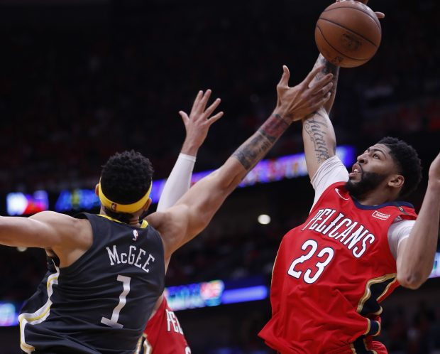 Golden State Warriors' Javale McGee (1) fights for a rebound against New Orleans Pelicans' Anthony Davis (23) in the third quarter of Game 3 of the NBA Western Conference semifinals at the Smoothie King Center in New Orleans, LA, on Friday, May 4, 2018. (Nhat V. Meyer/Bay Area News Group)