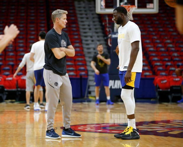 Golden State Warriors head coach Steve Kerr talks to Golden State Warriors' Draymond Green (23) during practice the day before Game 4 of the NBA Western Conference semifinals at the Smoothie King Center in New Orleans, LA, on Saturday, May 5, 2018. (Nhat V. Meyer/Bay Area News Group)