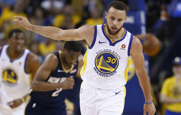 Golden State Warriors' Stephen Curry (30) celebrates his 2-point basket against the New Orleans Pelicans in the fourth quarter of Game 5 of the NBA Western Conference semifinals at Oracle Arena in Oakland, Calif., on Tuesday, May 8, 2018. (Nhat V. Meyer/Bay Area News Group)