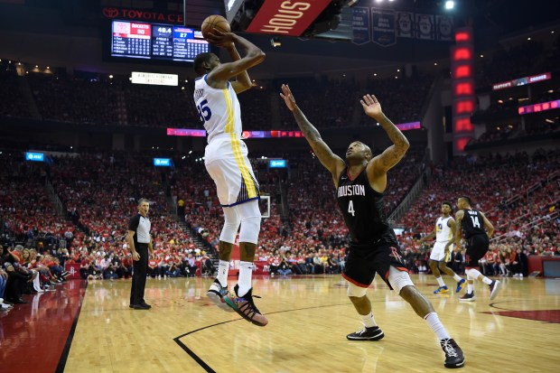 Golden State Warriors' Kevin Durant (35) shoots and makes a basket over Houston Rockets' PJ Tucker (4) during the first quarter of Game 1 of the NBA Western Conference finals at Toyota Center in Houston, Texas, on Monday, May 14, 2018. (Jose Carlos Fajardo/Bay Area News Group)