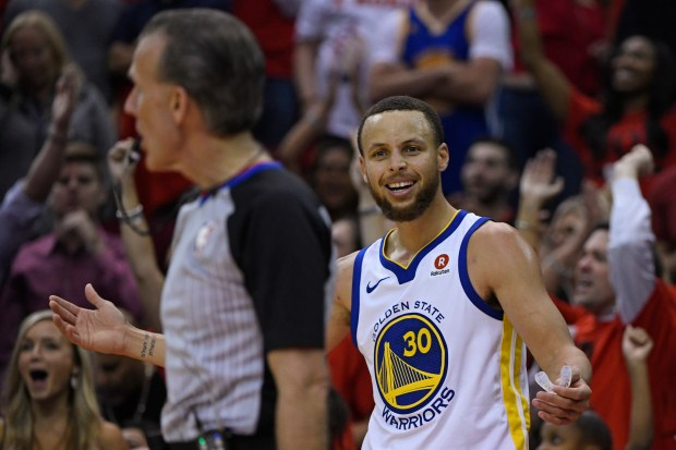 Golden State Warriors' Stephen Curry (30) argues a call with an official while playing against the Houston Rockets during the fourth quarter of Game 2 of the NBA Western Conference finals at Toyota Center in Houston, Texas, on Wednesday, May 16, 2018. The Houston Rockets defeated the Golden State Warriors 127-105. (Jose Carlos Fajardo/Bay Area News Group)