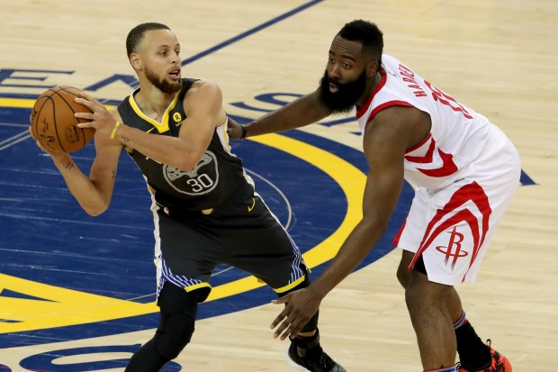 Golden State Warriors' Stephen Curry (30) attempts to pass the ball uinder pressure by Houston Rockets' James Harden (13) during the fourth quarter of Game 4 of the NBA Western Conference Finals at Oracle Arena in Oakland, Calif., on Tuesday, May 22, 2018. Warriors lost 92-95.(Ray Chavez/Bay Area News Group)