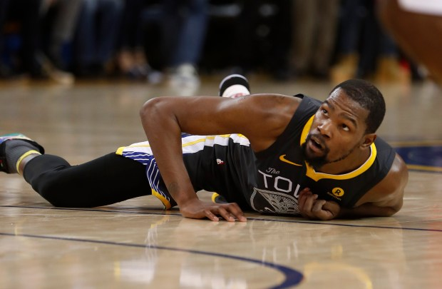 Golden State Warriors' Kevin Durant (35) lays on the floor after being fouled by the Houston Rockets in the second quarter of Game 4 of the NBA Western Conference finals at Oracle Arena in Oakland, Calif., on Tuesday, May 22, 2018. (Nhat V. Meyer/Bay Area News Group)