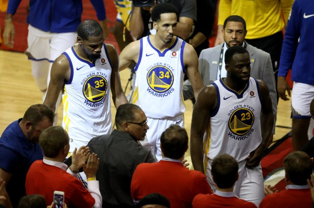 Golden State Warriors' Kevin Durant (35) Shaun Livingston (34) and Draymond Green (23) walk off the court following a 98-94 loss to the Houston Rockets in Game 5 of the NBA Western Conference finals at Toyota Center in Houston, Texas, on Thursday, May 24, 2018. (Anda Chu/Bay Area News Group)