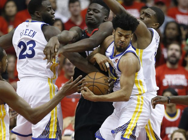 Golden State Warriors' Quinn Cook (4) fights for the ball against Houston Rockets' Clint Capela (15) in the second quarter of Game 5 of the NBA Western Conference finals at the Toyota Center in Houston, Texas., on Thursday, May 24, 2018. (Nhat V. Meyer/Bay Area News Group)