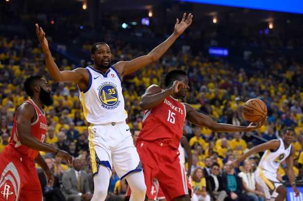 Golden State Warriors' Kevin Durant (35) throws up his hands following a play against Houston Rockets' James Harden (13) and Clint Capela (15) during the first quarter in Game 6 of the NBA Western Conference finals at Oracle Arena in Oakland, Calif., on Saturday, May 26, 2018. (Jose Carlos Fajardo/Bay Area News Group)