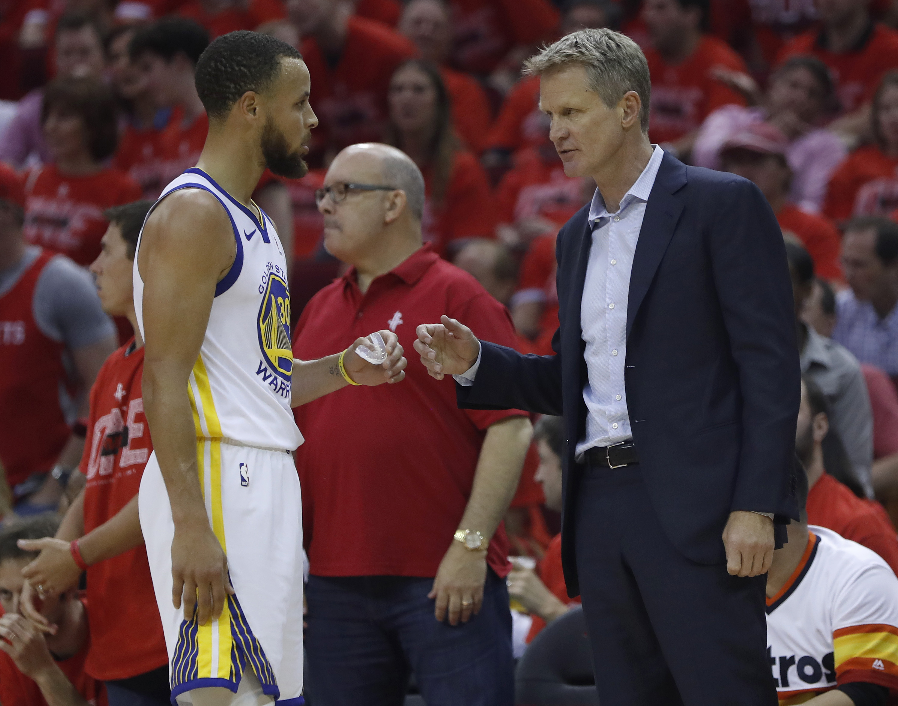 Golden State Warriors head coach Steve Kerr talks to Golden State Warriors Stephen Curry during a timeout during their game against the Houston Rockets in the first quarter of Game 7 of the NBA Western Conference finals at the Toyota Center in Houst