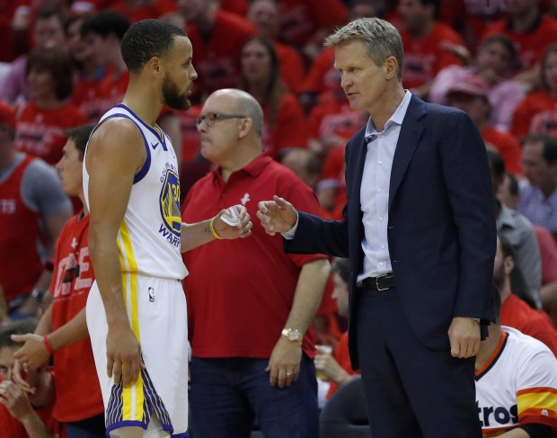 Golden State Warriors head coach Steve Kerr talks to Golden State Warriors' Stephen Curry (30) during a timeout during their game against the Houston Rockets in the first quarter of Game 7 of the NBA Western Conference finals at the Toyota Center in Houston, Texas, on Monday, May 28, 2018. (Nhat V. Meyer/Bay Area News Group)