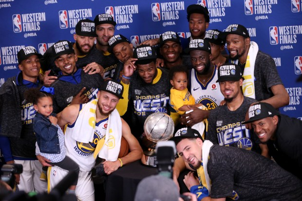 The Golden State Warriors pose for a photo following a trophy presentation after beating the Houston Rockets 101-92 in Game 7 to claim the NBA Western Conference championship at Toyota Center in Houston, Texas, on Monday, May 28, 2018. (Anda Chu/Bay Area News Group)