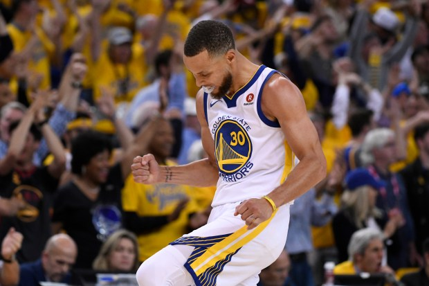 Golden State Warriors' Stephen Curry (30) pumps his fist after making a 3-point basket against the Cleveland Cavaliers during the fourth quarter of Game 1 of the NBA Finals at Oracle Arena in Oakland, Calif., on Thursday, May 31, 2018. Golden State Warriors defeated the Cleveland Cavaliers 124-114 in overtime. (Jose Carlos Fajardo/Bay Area News Group)