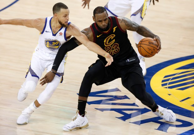 Golden State Warriors' Stephen Curry (30) defends against Cleveland Cavaliers' LeBron James (23) in the fourth quarter of Game 1 of the NBA Finals at Oracle Arena in Oakland, Calif., on Thursday, May 31, 2018. (Nhat V. Meyer/Bay Area News Group)