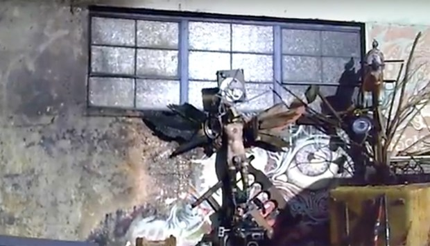 In this screengrab from police body camera video, statues and other items rest against the wall of the Ghost Ship warehouse after the report of a fire there in 2014. (Courtesy of Oakland Police Department)