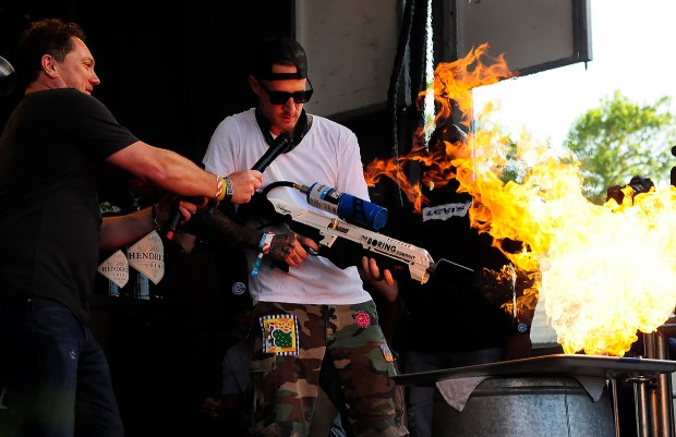 Chef Michael Voltaggio uses a BORING Company flame thrower to blacken some chicken on the Williams Sonoma Culinary Stage at BottleRock on Saturday, May 26, 2018 in Napa, California. (Chris Riley/Times-Herald)