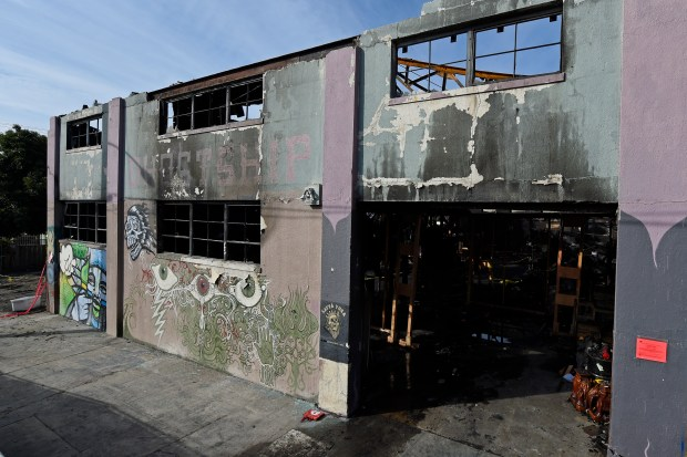 View of the front entrance of the Ghost Ship warehouse building in Oakland, Calif. on Monday, Dec. 12, 2016. The Dec. 2nd fire tore through the two-story building on the 1300 block of 31st Avenue killing 36 people. (Jose Carlos Fajardo/Bay Area News Group)