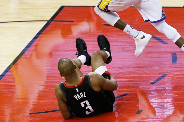HOUSTON, TX - MAY 24: Chris Paul #3 of the Houston Rockets grabs his leg after falling against the Golden State Warriors in the fourth quarter of Game Five of the Western Conference Finals of the 2018 NBA Playoffs at Toyota Center on May 24, 2018 in Houston, Texas. (Photo by Bob Levey/Getty Images)