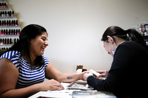 "Anabel Jimenez, left, gets her nails done at Blossom Nail Salon in Campbell, Calif., on Tuesday, May 1, 2018. Blossom Nail Salon was among the first in Santa Clara County to be designated ""healthy"" by eliminating toxic products and providing more ventilation for workers among other things. (Randy Vazquez/ Bay Area News Group)"