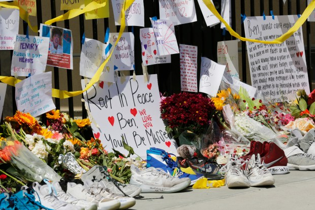 Students at San Ramon Valley High School in Danville, Calif., mourn the loss of a fellow student Ben Curry outside the pool putting flowers, notes and shoes outside the gate on Wednesday, May 9, 2018. Curry was found in the campus pool on Tuesday. (Laura A. Oda/Bay Area News Group)