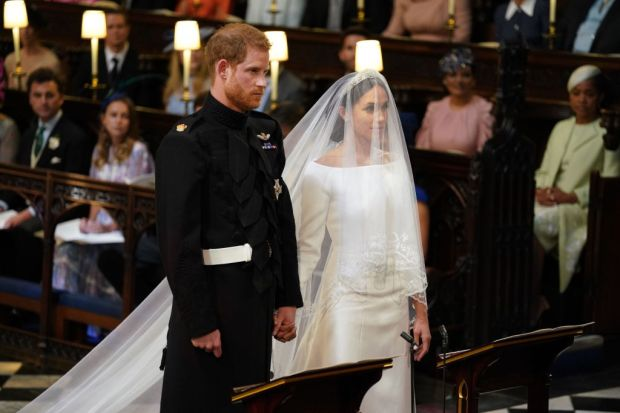 Prince Harry and Meghan Markle stand together in St George's Chapel at Windsor Castle for their wedding on May 19, 2018 in Windsor, England. (Photo by Dominic Lipinski - WPA Pool/Getty Images)