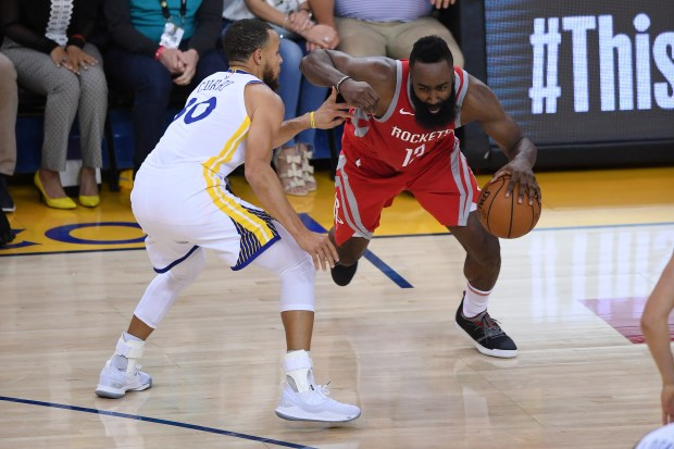 OAKLAND, CA - MAY 26: James Harden #13 of the Houston Rockets drives with the ball against Stephen Curry #30 of the Golden State Warriors during Game Six of the Western Conference Finals in the 2018 NBA Playoffs at ORACLE Arena on May 26, 2018 in Oakland, California. NOTE TO USER: User expressly acknowledges and agrees that, by downloading and or using this photograph, User is consenting to the terms and conditions of the Getty Images License Agreement. (Photo by Thearon W. Henderson/Getty Images)