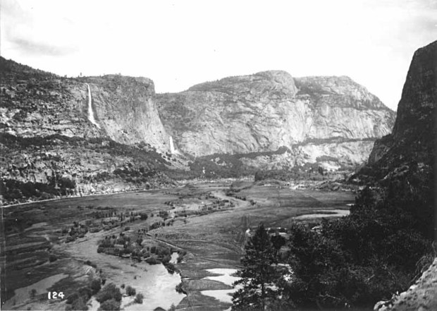 View across Hetch Hetchy Valley, early 1900s, from the southwestern end, showing the Tuolumne River flowing through the lower portion of the valley prior to damming. (National Park Service)