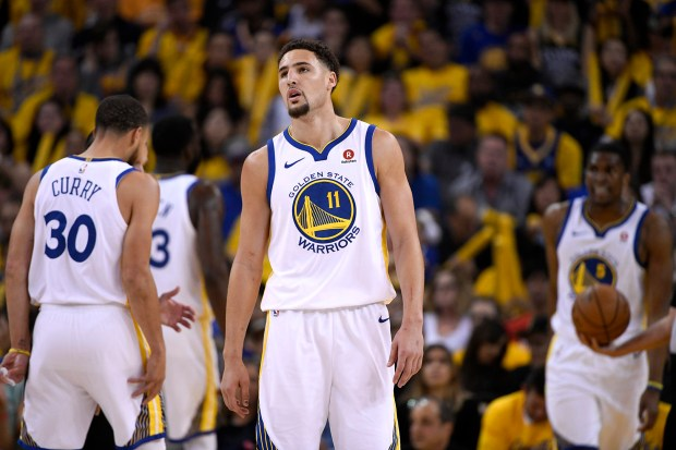 Golden State Warriors' Klay Thompson (11) looks up during the first quarter in Game 6 of the NBA Western Conference finals against the Houston Rockets at Oracle Arena in Oakland, Calif., on Saturday, May 26, 2018. (Jose Carlos Fajardo/Bay Area News Group)