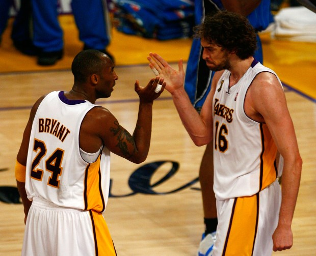 LOS ANGELES, CA - JUNE 07: Kobe Bryant #24 and Pau Gasol #16 of the Los Angeles Lakers celebrate a basket in overtime against the Orlando Magic in Game Two of the 2009 NBA Finals at Staples Center on June 7, 2009 in Los Angeles, California. NOTE TO USER: User expressly acknowledges and agrees that, by downloading and or using this photograph, User is consenting to the terms and conditions of the Getty Images License Agreement. (Photo by Jeff Gross/Getty Images)