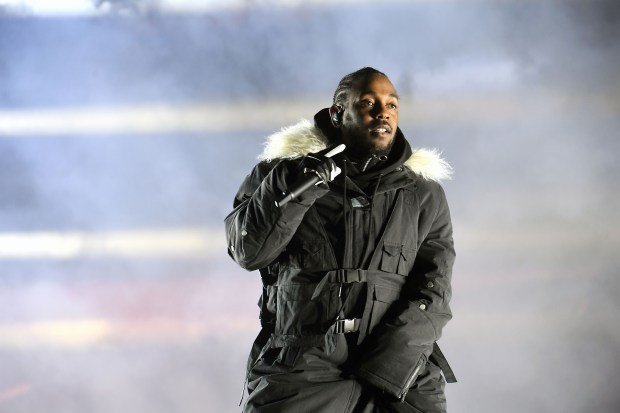 ATLANTA, GA - JANUARY 08: Rapper Kendrick Lamar performs during half time during 2018 College Football Playoff National Championship Game at Centennial Olympic Park on January 8, 2018 in Atlanta, Georgia. (Photo by Paras Griffin/Getty Images)