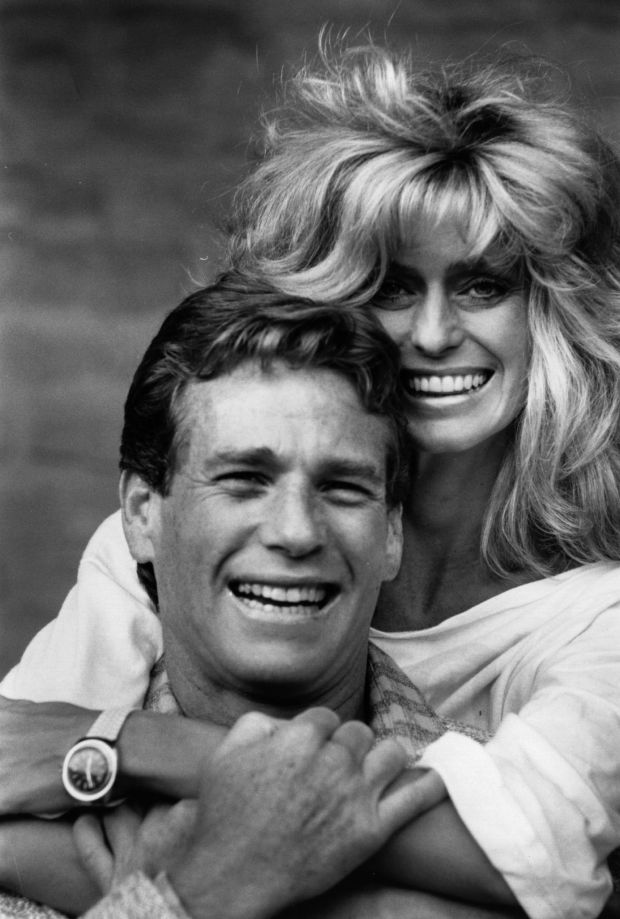 American actor Ryan O'Neal with actress Farrah Fawcett. (Photo by Express Newspapers/Getty Images)